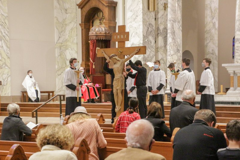 Those in attendance venerated the Crucifix from their seats. The Message photo by Tim Lilley