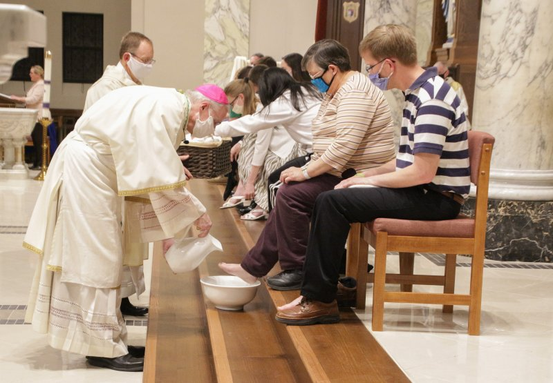 After the homily, Bishop Siegel washed the feet of 12 people who attended the Mass. The Message photo by Tim Lilley