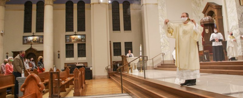 Deacon David Rice incenses those in attendance. The Message photo by Tim Lilley