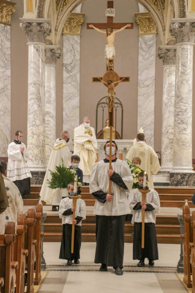 Bishop Siegel transfers the Blessed Sacrament to the place of reposition. The Message photo by Tim Lilley