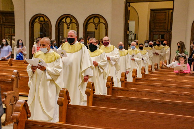 More than 45 priests of the Diocese of Evansville process into St. Benedict Cathedral at the start of the March 30 diocesan Chrism Mass. The Message photo by Tim Lilley