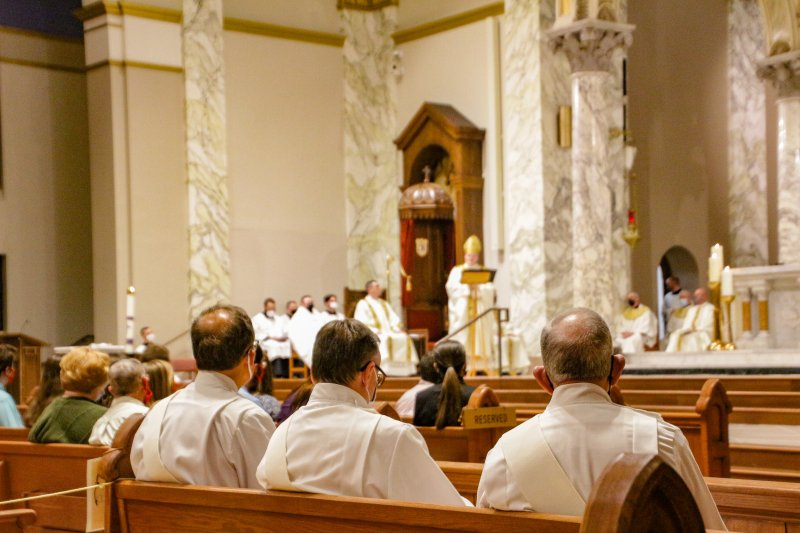 Deacons, in the foreground, listen to Bishop Siegel's homily during the Chrism Mass. The Message photo by Tim Lilley