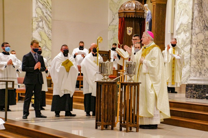 Bishop Siegel blesses the Sacred Chrism. The Message photo by Tim Lilley