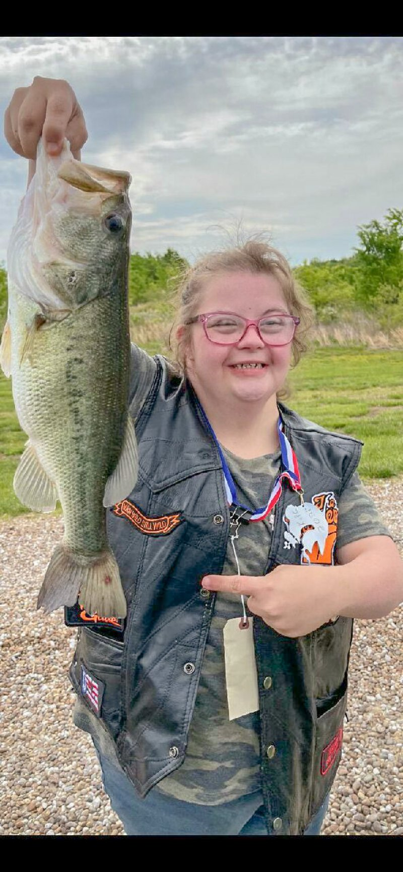 Tess Fuller of Boonville shows off the 18-inch largemouth bass she landed during the 2021 Knights of Columbus Special Needs Fishing Tournament, held May 15. Submitted photo