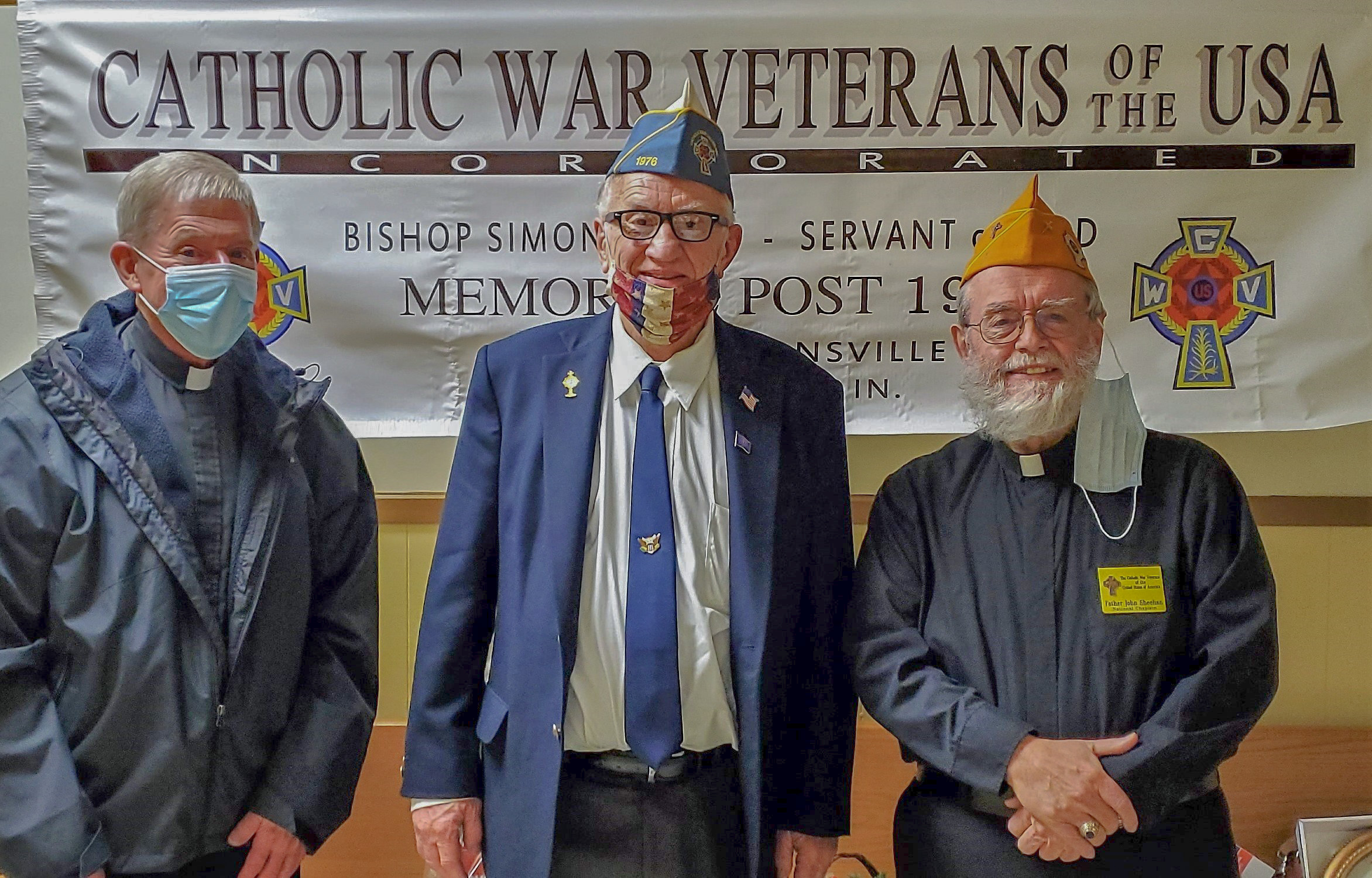 """Father Kenneth Walker, left, Chaplain of Post 1976 of the Catholic War Veterans of the USA, joins post Commander George """"Bud"""" Erler and Jesuit Father John R. Sheehan, National Chaplain of the Catholic War Veterans, for a photo during Father Sheehan's visit to Post 1976. Submitted photo"""