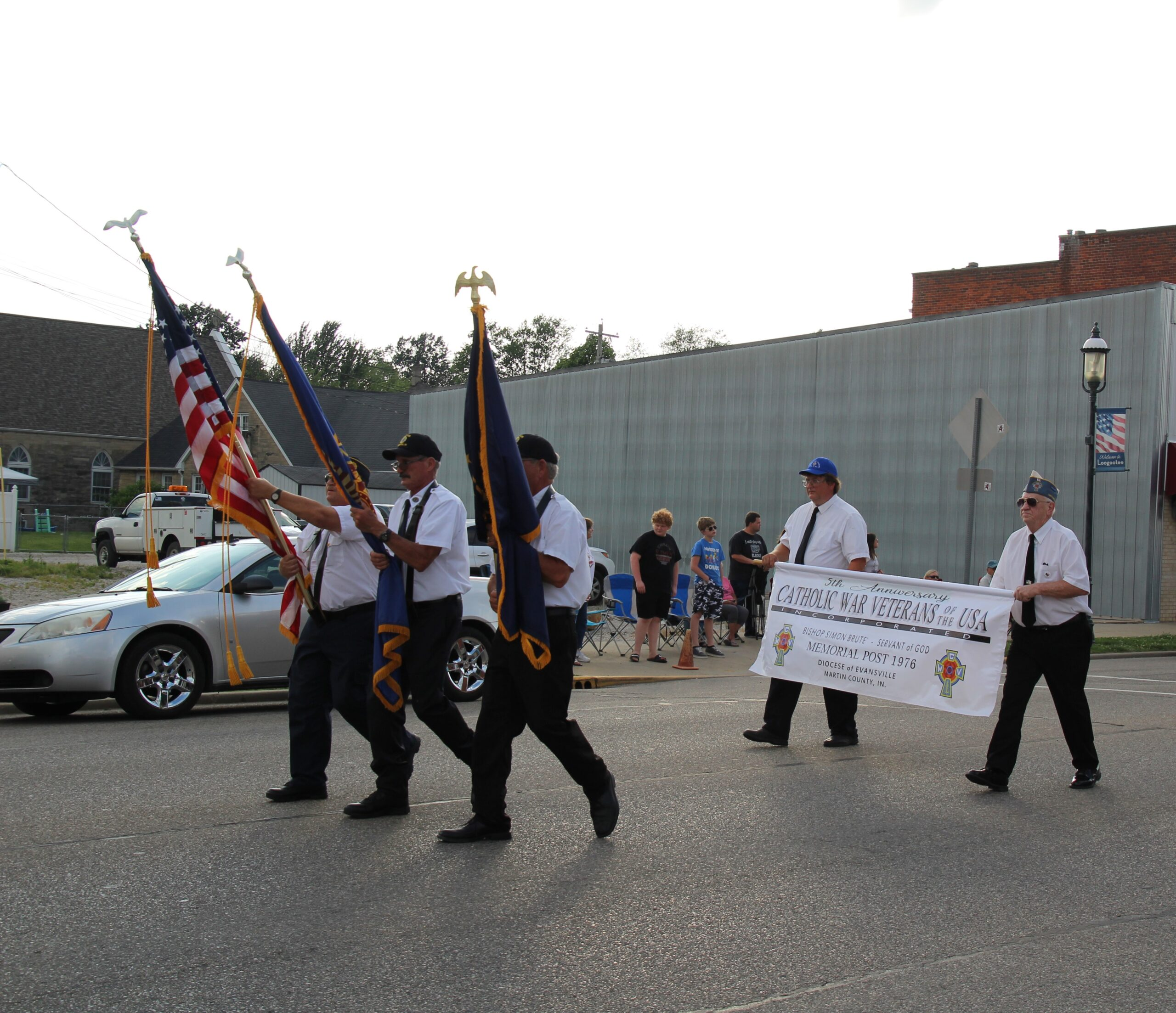 The Catholic War Veterans Post 1976 presented the colors for the 2021 Loogootee Summerfest parade June 26, which was also Post 1976's 5th anniversary of formal installation within the Diocese of Evansville. This is the first Post of Catholic War Veterans in the State of Indiana, according to members. Pictured are Dan Forrester, front row left, Paul Truelove, Phil Todd, Mike Jones, back row left, and Bud Erler. Submitted photo