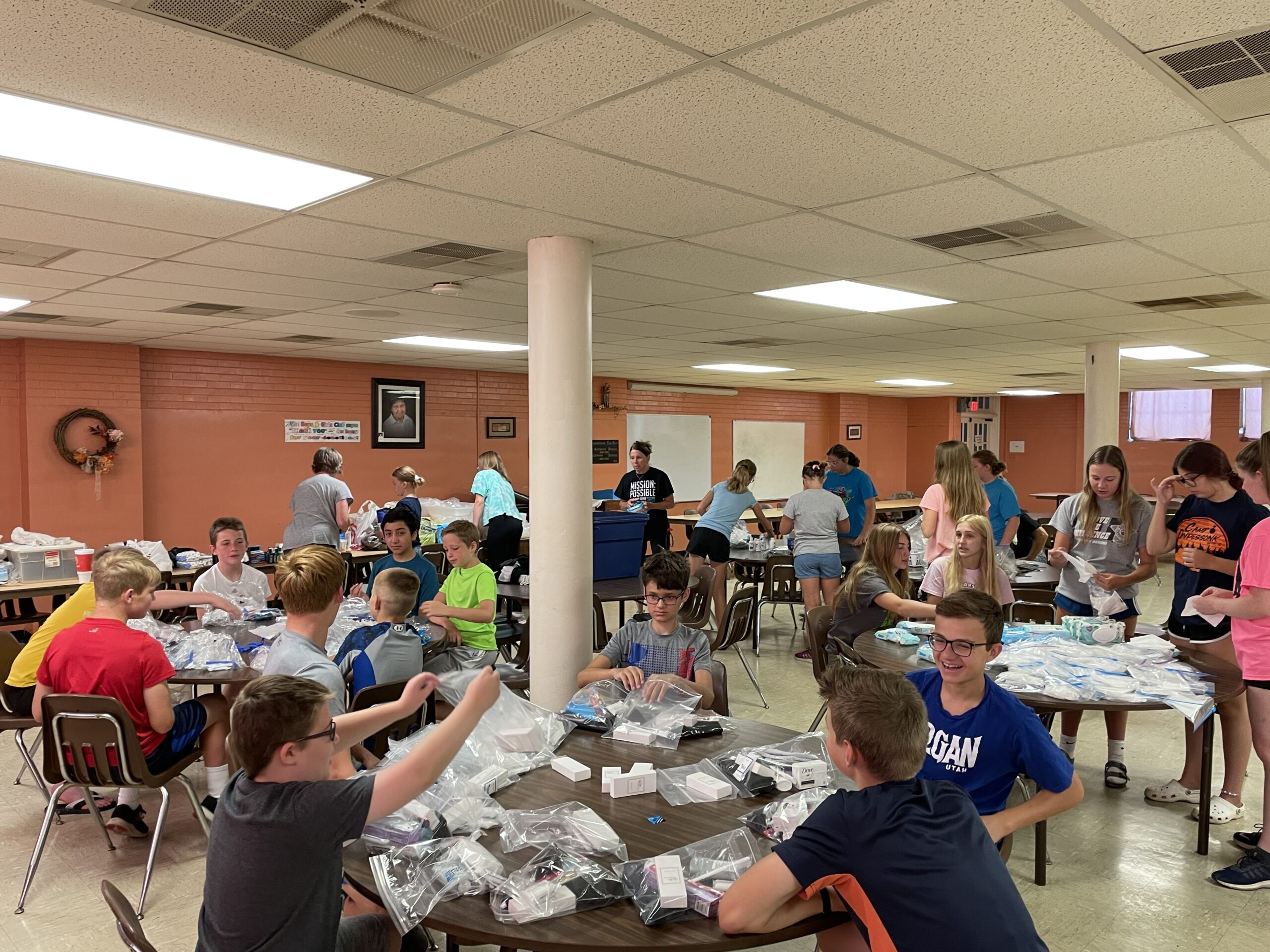 Each Monday in June, Holy Redeemer Parish and All Saints Parish youth had opportunities to serve the community at different locations. On June 28, they gathered at St. Anthony of Padua Church's cafeteria in Evansville to assemble necessity bags for the All Saints Soup Kitchen and Clothes Closet.  Submitted photo