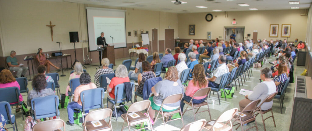 Bishop Joseph M. Siegel welcomes a large group of catechists from across the Diocese of Evansville as he opens Formation Day with a prayer service Aug. 28 at the Catholic Center in Evansville. The Message photo by Tim Lilley