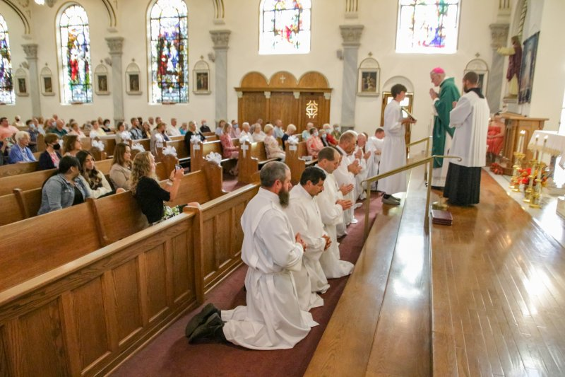 Bishop Siegel blesses the 12 candidates for the permanent diaconate, who are scheduled to be ordained in the summer of 2022. The Message photo by Tim Lilley