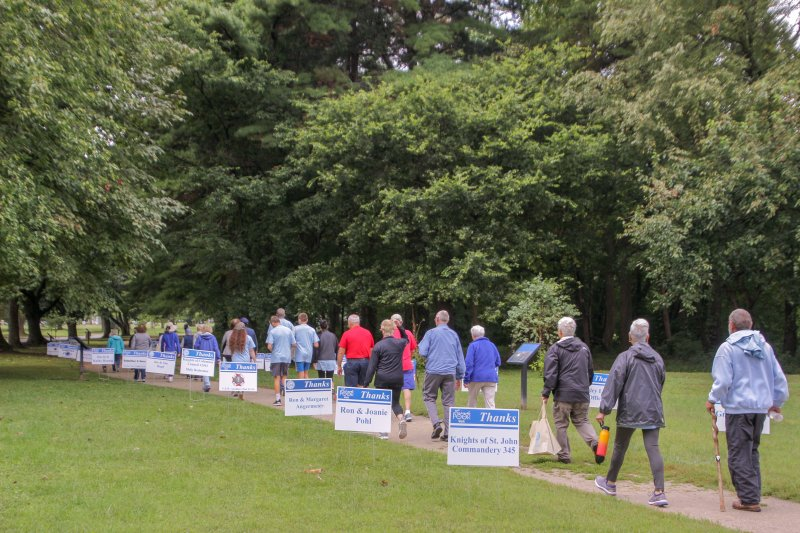 As they began the one-mile loop around the grounds of the Evansville State Hospital, walkers passed through a lane of signs recognizing sponsors. The Message photo by Tim Lilley