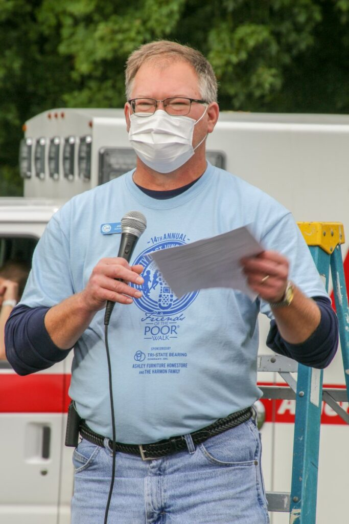 Joe Cook, executive director of the Evansville district of St. Vincent de Paul, tells the crowd that the event raised $27,000 through sponsorship this year, well above the goal of $25,000. The Message photo by Tim Lilley