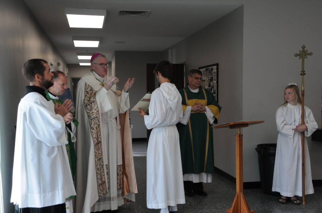 During his blessing, Bishop Joseph M. Siegel, third from left, said the building is something the Lord built through parish sacrifices, commitment in faith and hard work. Also pictured are Matt Miller, left, diocesan director of the Office of Worship, Father Tony Ernst, administrator of St. Philip Neri Parish, and Deacon Paul Vonderwell, fifth from left. The Message photo by Megan Erbacher