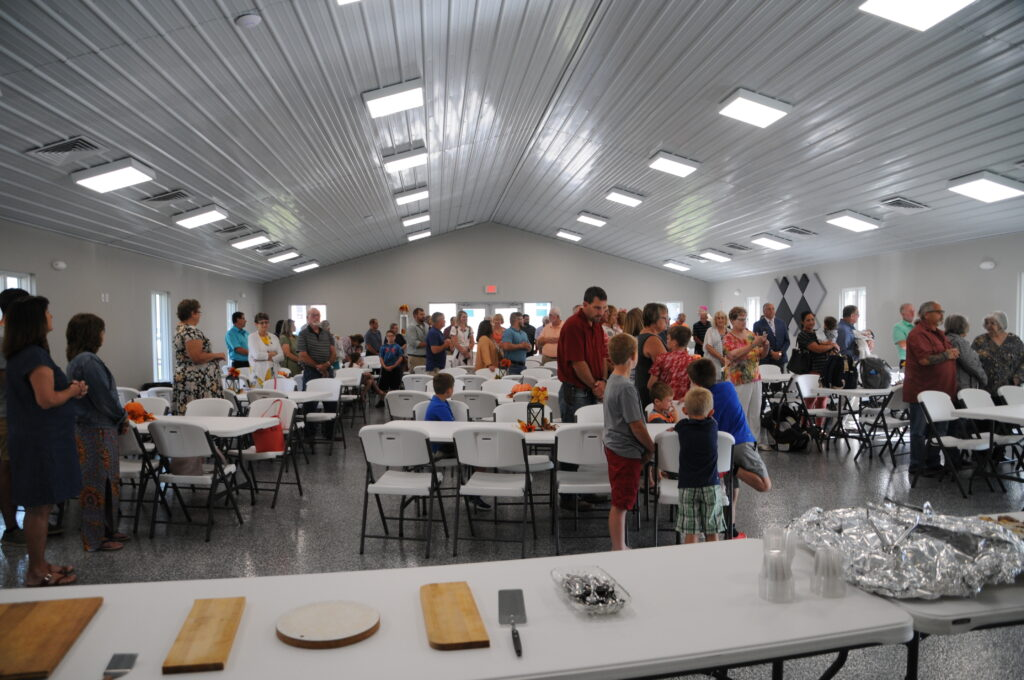 St. Philip Neri parishioners gathered for Bishop Joseph M. Siegel's blessing and dedication of the new parish hall Aug. 29. The Message photo by Megan Erbacher