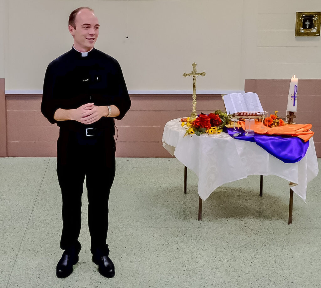 Father Tyler Tenbarge, Diocese of Evansville Director of Vocations, Director of the Father Deydier House of Discernment and part-time Parochial Vicar at Corpus Christi Parish in Evansville, leads the breakout session on praying with the saints. Photo by Joe Falcony, special to The Message