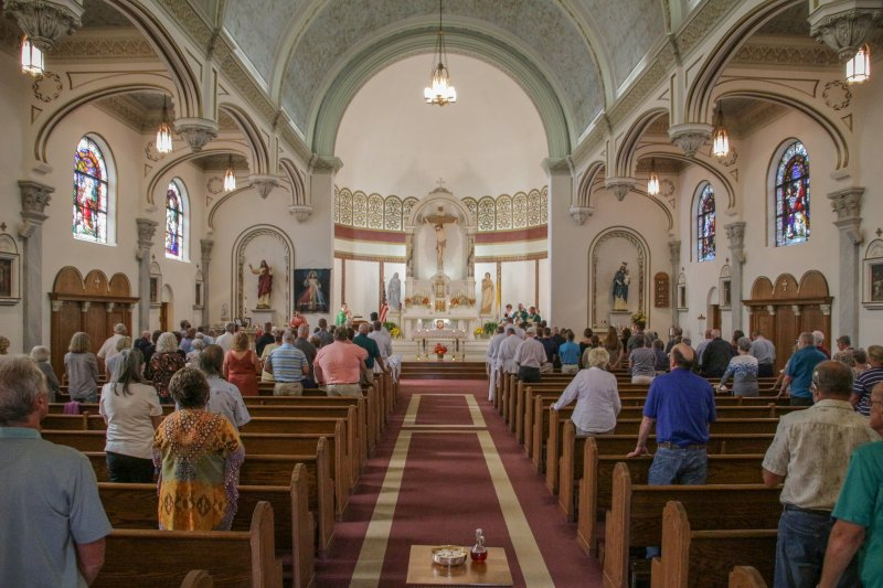 Bishop Joseph M. Siegel celebrated the 5 p.m. EDT Mass at St. Francis Xavier Parish's Sacred Heart Church in Vincennes Sept. 18, during which he installed 12 candidates for the Diocese of Evansville's permanent diaconate to the Ministry of Acolyte. The Message photo by Tim Lilley
