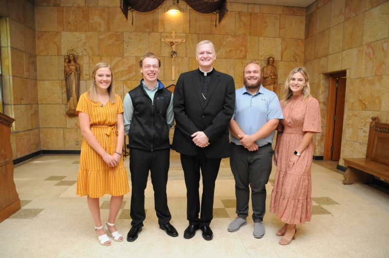 University of Southern Indiana FOCUS missionaries attended Mass celebrated by Bishop Joseph M. Siegel Aug. 3. Pictured after Mass are Megan St Aubin, left, Thomas Horlander, Bishop Siegel, Zach Piorkowski and Taylor Homan. The Message photo by Megan Erbacher