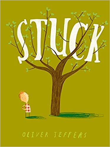 "Book cover of ""Stuck"", featuring a child, standing on the ground, looking up at the top of a tree."