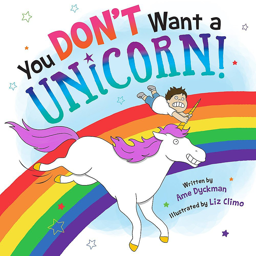 "Book cover: ""You Don't Want a Unicorn"". A boy rides a unicorn with purple mane. They are flying past a rainbow."