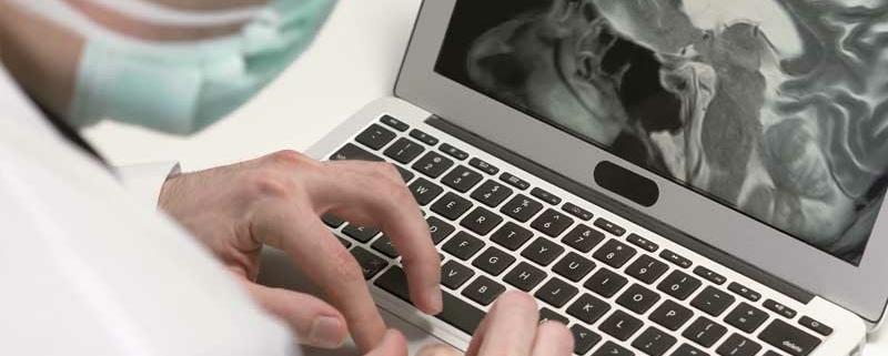Doctor viewing laptop
