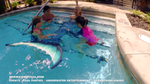 Mermaid swims in lazy river with children