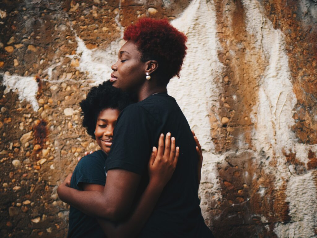 Mother and Child holding each other recovery from addiction