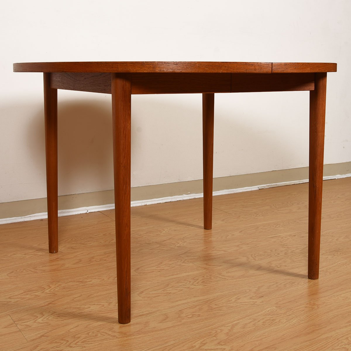 43.5″ Danish Teak Compact Round-to-Oval Expanding Dining Table