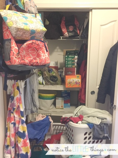 messy laundry room before renovation
