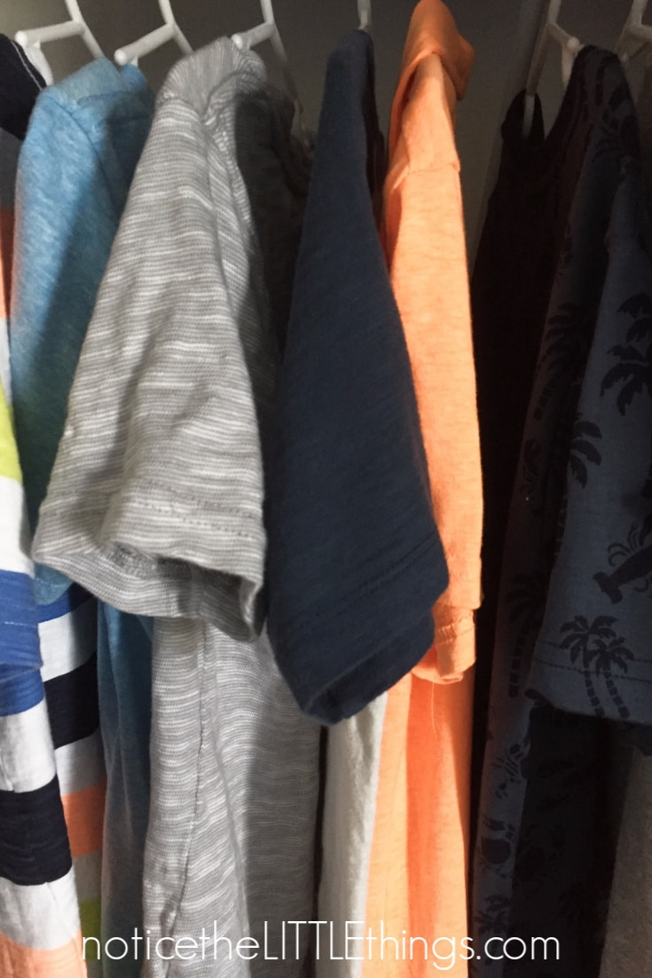 boys clothes hanging in a closet