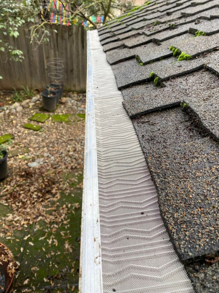 Installing gutter guards, such as the LeafBlaster Pro, can help prevent clogged downspouts.