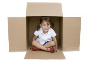 girl-inside-moving-boxes