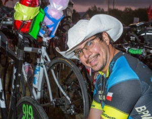 man in cowboy hat gets ready in transition for the kerrville triathlon