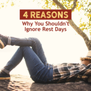 Man takes a nap on the ground by a tree with his hat over his face. Text on design reads 4 Reasons Why You Shouldn't Ignore Rest Days. Learn more at https://kerrvilletri.com/2021/01/rest-days/