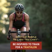 Cyclist rides her bike on a road through a forrest during a triathlon. Text on design reads Don't Let People Say You Can't - Be Inspired to Train for a Triathlon. Read more at https://kerrvilletri.com/2021/07/dont-let-others-say-you-cant-complete-a-triathlon