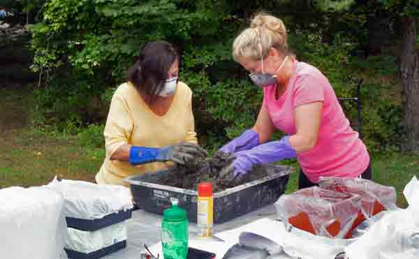 Garden Club members constructing hypertufa troughs