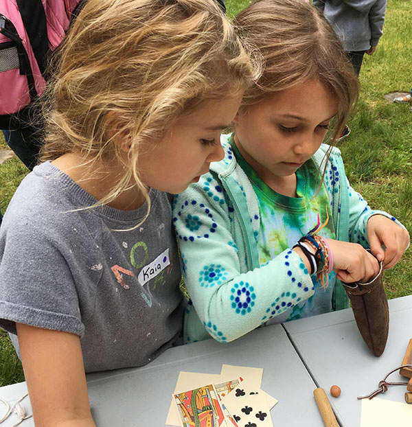 Madison, Connecticut second graders check out the colonial jacks at the Deacon John Grave House event