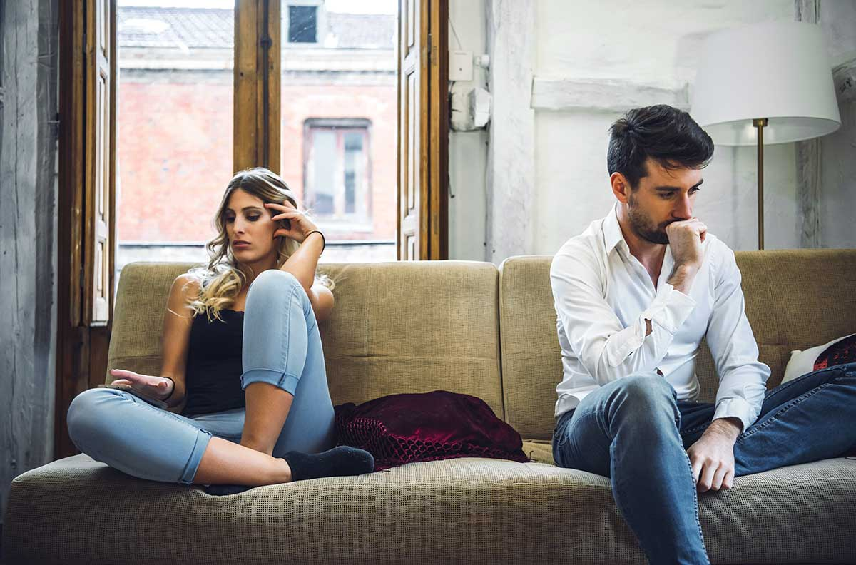 unhappy-divorcing-couple-on-couch