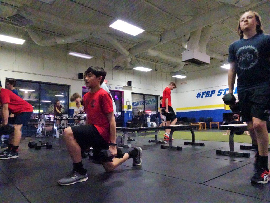 fsp team training athletes performing split squats