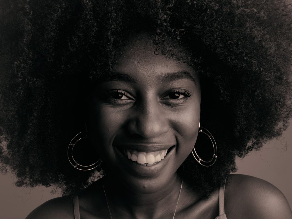 smiling woman in black spaghetti strap top