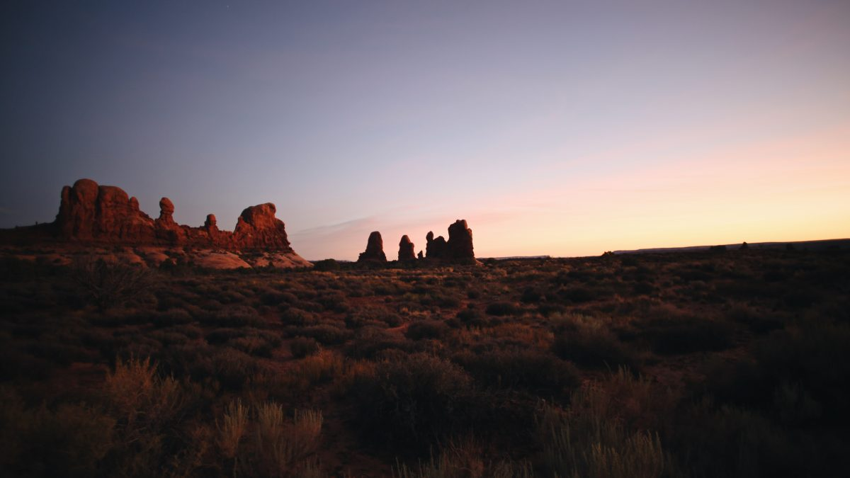 brown rock formation during sunset