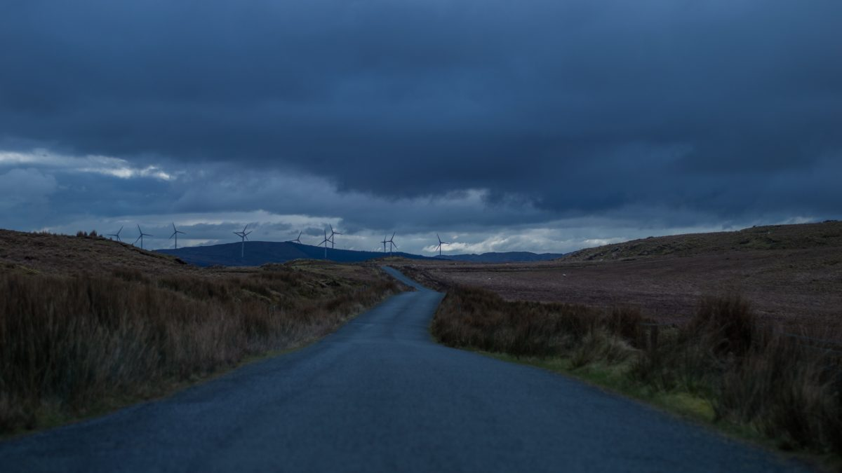 road going to field with wind turbines