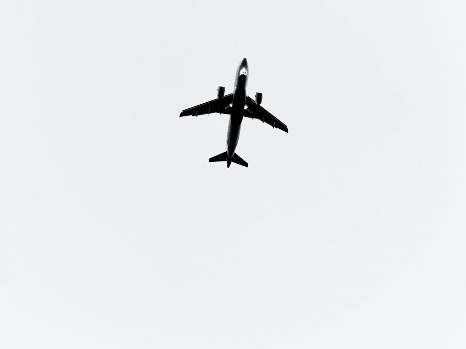 black airplane in mid air