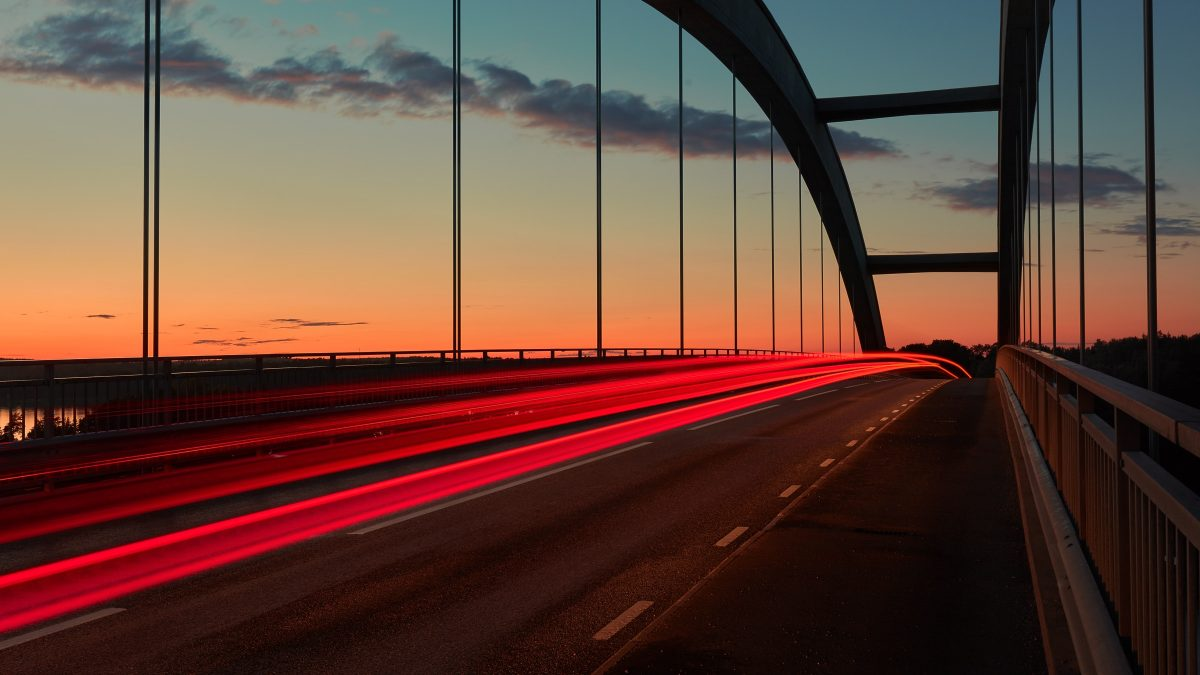 time lapse photo of cable bridge during golden hour