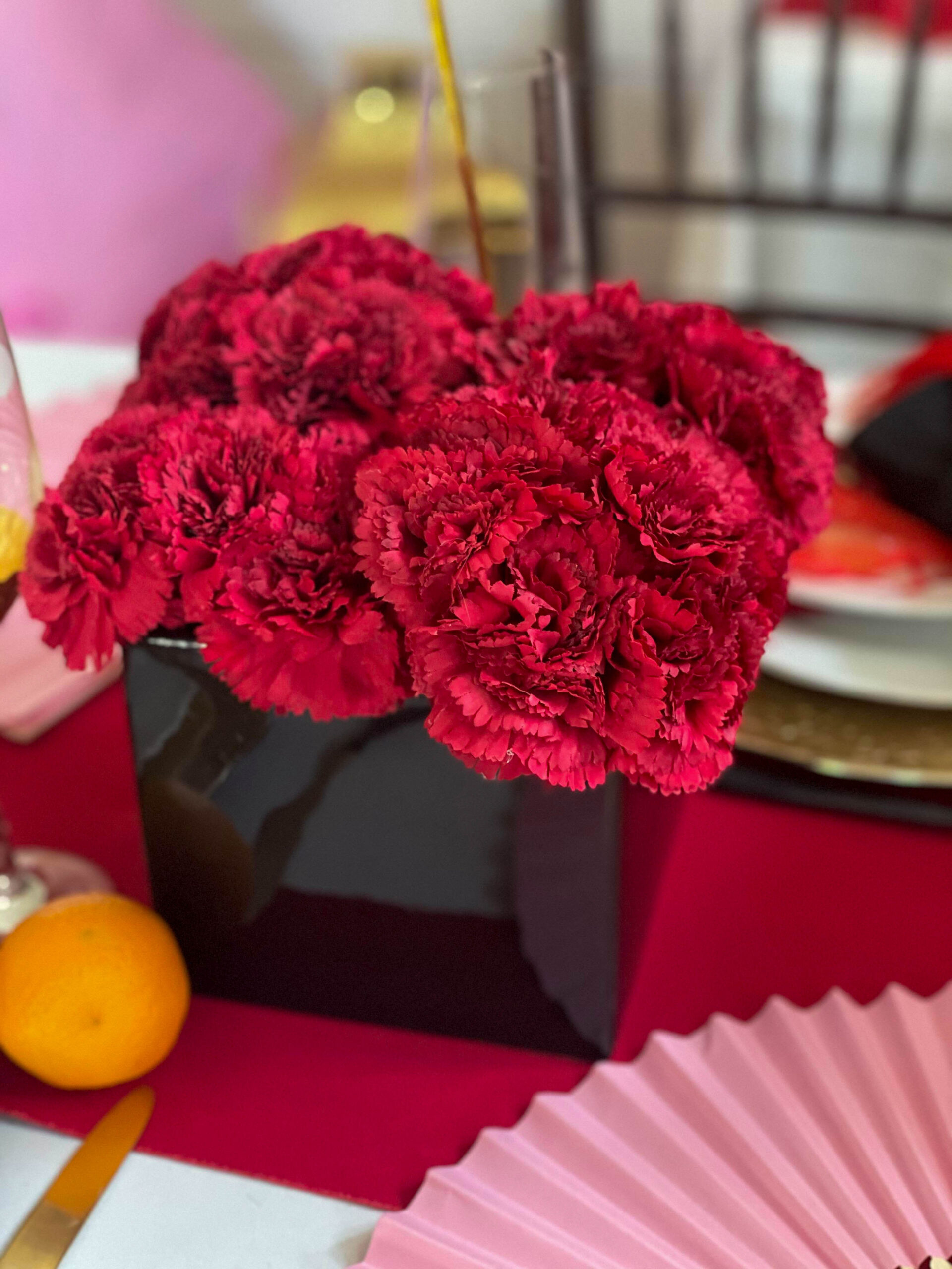red carnation centerpiece for Chinese New Year