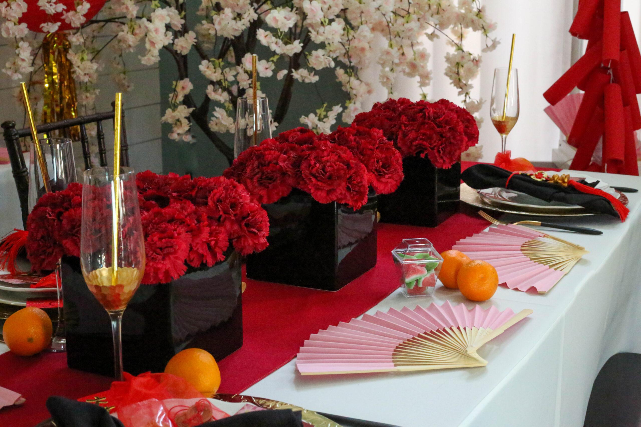 red carnation centerpiece vases