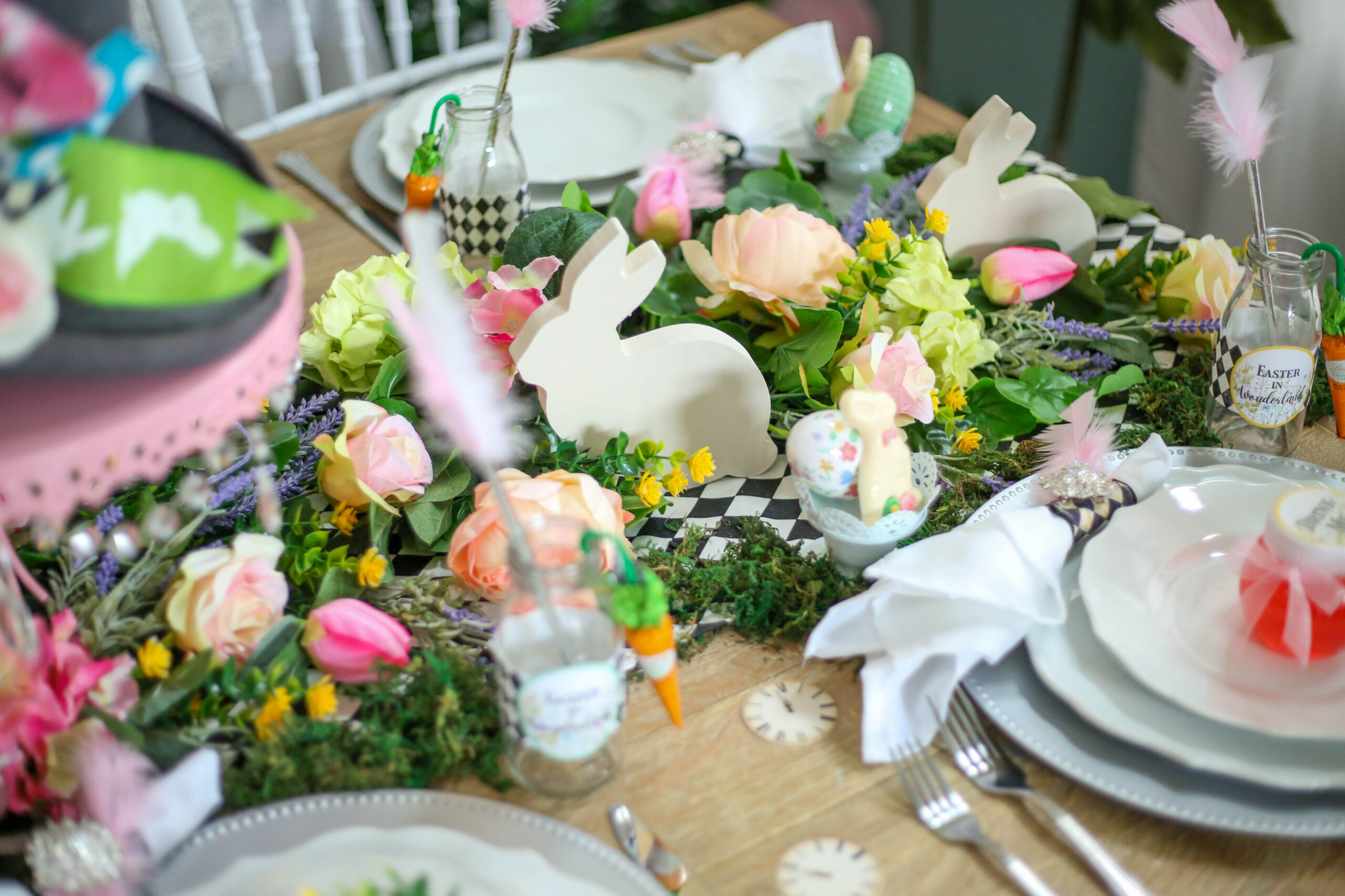wood cut bunnies in a floral tablescape for easter
