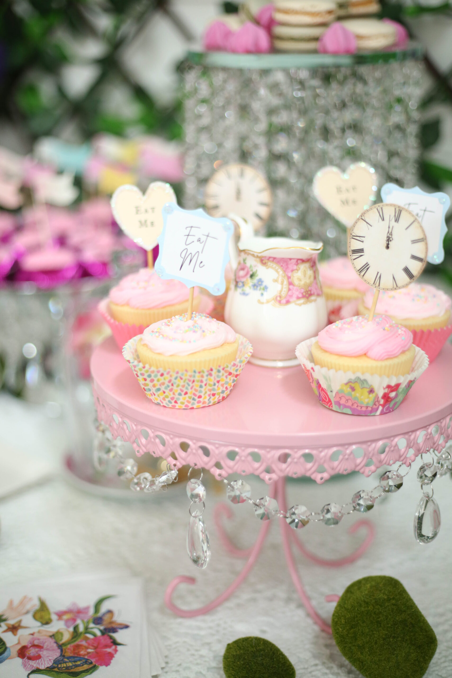 Easter cupcakes on a pink cake stand with crystals