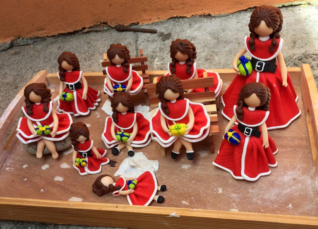 Christmas dolls drying on the patio