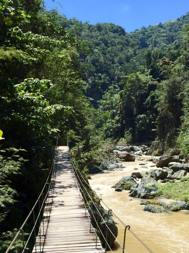 swinging bridge by Rio Yaque del Norte