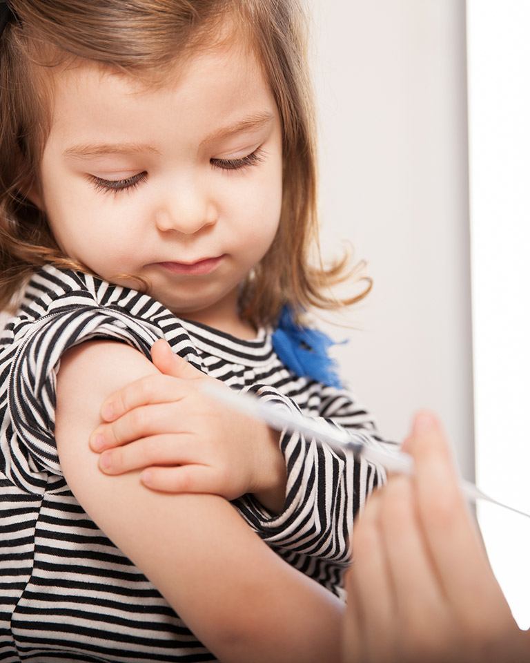 little girl getting a vaccination