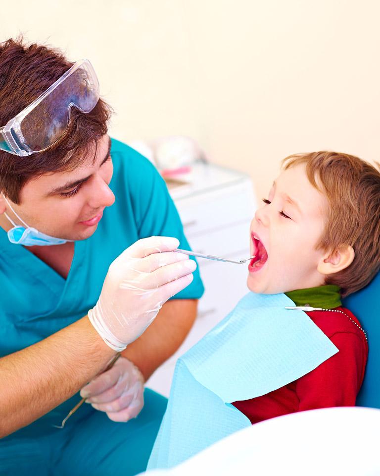 little boy at the dentist